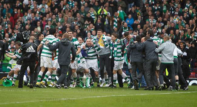 Celtic players form a huddle around the Scottish Cup