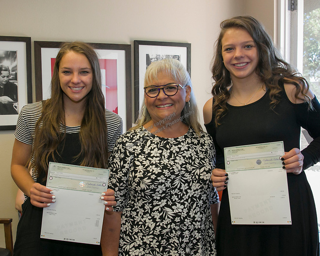 Left to right:  Taylor Crofoot, President & Ceo Isabelle Rodriguez Wilson, left, and Morgan Crofoot during the Nevada Women's Fund Scholarship distribution, June 20, 2019.