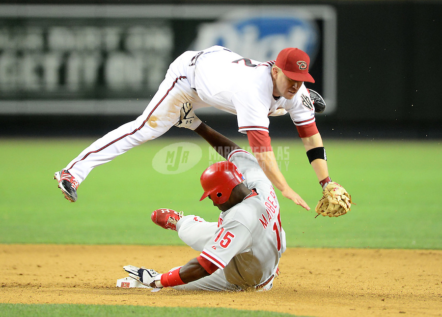 Apr. 23, 2012; Phoenix, AZ, USA; Arizona Diamondbacks second baseman Aaron Hill leaps in the air after forcing out Philadelphia Phillies base runner (15) John Mayberry Jr to start a double play in the ninth inning at Chase Field. Mandatory Credit: Mark J. Rebilas-