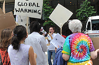 Demonstrators from several groups including the Little Village Environmental Justice Organization, the Rainforest Action Network, and Loyola University protest against Chicago's two coal generated power plants on the city's South Side during the lunch rush in the Daley Center in downtown Chicago, Illinois on June 8, 2009.