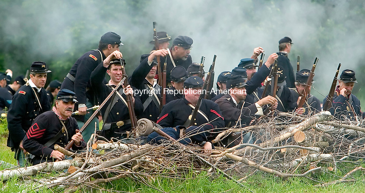 GOSHEN, CT--17 JUNE 2006 -061706JS35- Union troops engage the Confederate soldiers during the 'Battle at Wadham's Grove during the Civil War encampment in Goshen. The reenactment depicts the Jackson Valley Campaign.  -- Jim Shannon Republican-American