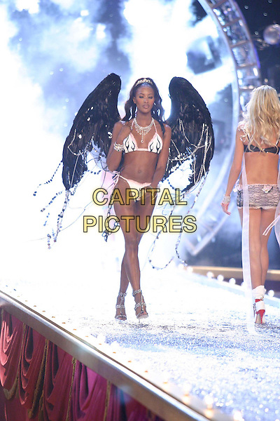 NAOMI CAMPBELL.9th Annual Victoria's Secret Fashion Show Inside.Lexington Avenue Armory.catwalk, lingerie, belly, stomach, midriff, underwear, full length, full-length, wings, angel.www.capitalpictures.com.sales@capitalpictures.com.©Capital Pictures