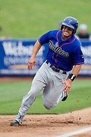 James Cesario (9) of the Tulsa Drillers rounds third base during a game against the Springfield Cardinals at Hammons Field on June 27, 2011 in Springfield, Missouri. (David Welker / Four Seam Images)