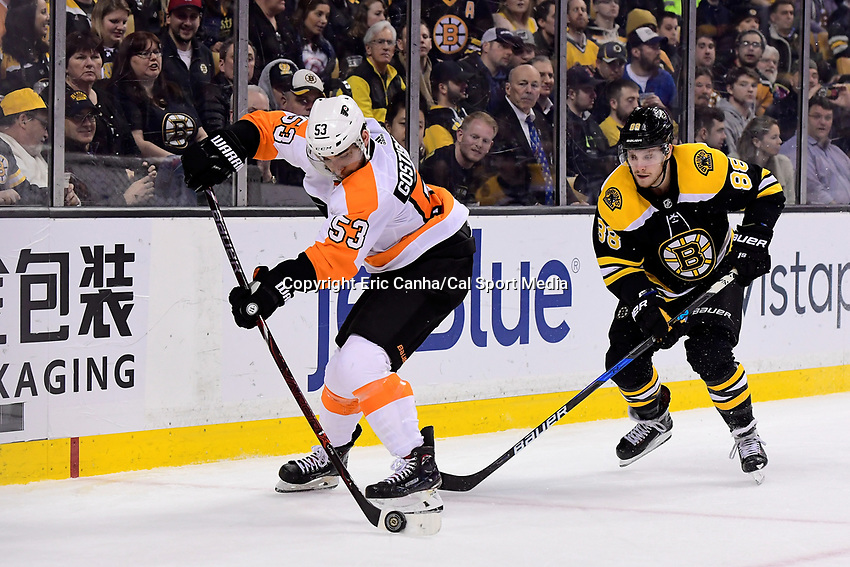 March 8, 2018: Philadelphia Flyers defenseman Shayne Gostisbehere (53) and Boston Bruins right wing David Pastrnak (88) in game action during the NHL game between the Philadelphia Flyers and the Boston Bruins held at TD Garden, in Boston, Mass. Boston defeats Philadelphia 3-2 in regulation time. Eric Canha/CSM