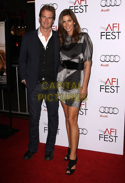 "RANDE GERBER & CINDY CRAWFORD.AFI FEST 2009 Screening Of ""A Single Man"" Closing Night Gala held At The Grauman's Chinese Theatre, Hollywood, California, USA..November 5th, 2009.full length black suit jacket jeans denim cardigan grey gray dress belt pattern hand in pocket randy cut out peep toe shoes married husband wife .CAP/ADM/KB.©Kevan Brooks/AdMedia/Capital Pictures."