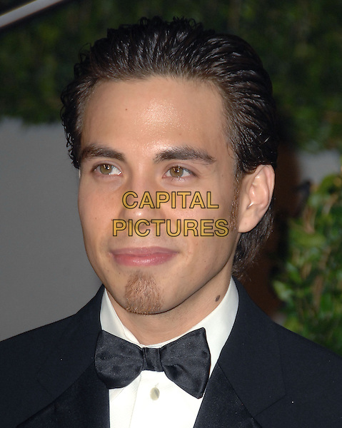 APOLO ANTON OHNO.The 2010 Vanity Fair Oscar Party held at The Sunset Tower Hotel in West Hollywood, California, USA..March 7th, 2010.oscars headshot portrait black white bow tie goatee facial hair .CAP/RKE/DVS.©DVS/RockinExposures/Capital Pictures.