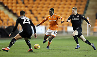 Blackpool's Marc Bola under pressure from Barnsley&rsquo;s Daniel Pinillos (left) and Mike-Steven B&auml;hre<br /> <br /> Photographer Rich Linley/CameraSport<br /> <br /> The EFL Sky Bet League One - Blackpool v Barnsley - Saturday 22nd December 2018 - Bloomfield Road - Blackpool<br /> <br /> World Copyright &copy; 2018 CameraSport. All rights reserved. 43 Linden Ave. Countesthorpe. Leicester. England. LE8 5PG - Tel: +44 (0) 116 277 4147 - admin@camerasport.com - www.camerasport.com