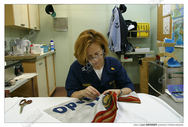 Physical Thereapist, Lt. Paula Godes works on a commemorative quilte, which will hang in the ship upon completion. USNS COMFORT Naval hospital ship in the Persian Gulf.