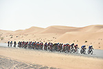 The peloton pass through desert terrain during Stage 3 The Silicon Oasis Stage of the Dubai Tour 2018 the Dubai Tour&rsquo;s 5th edition, running 180km from Skydive Dubai to Fujairah, Dubai, United Arab Emirates. 7th February 2018.<br /> Picture: LaPresse/Fabio Ferrari | Cyclefile<br /> <br /> <br /> All photos usage must carry mandatory copyright credit (&copy; Cyclefile | LaPresse/Fabio Ferrari)