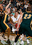 JANUARY 30, 2015 -- Brett Hartshore #15 of Regis University drives between Riley Ryan #32 and Tate Hilgenkamp #23 of Black Hills State during their Rocky Mountain Athletic Conference men's basketball game Friday evening at the Donald E. Young Center in Spearfish, S.D.  (Photo by Dick Carlson/Inertia)