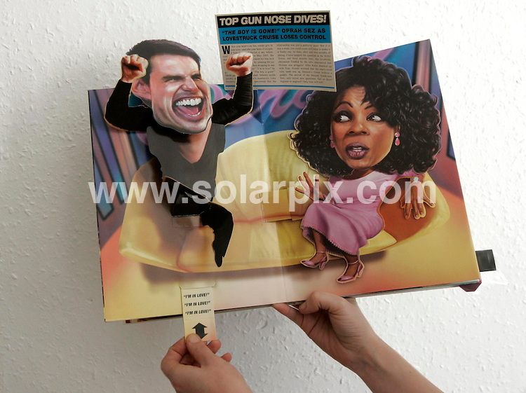 """ALL ROUND PICTURES FROM SOLARPIX.COM.**NO PUBLICATION IN FRANCE, SCANDANAVIA, AUSTRALIA AND GERMANY** UK RESTRICTIONS: NO NEWSPAPER PUBLICATION, MAGAZINES ONLY**.This is the ultimate pop-up book for adults - """"Celebrity Meltdowns"""" is the brainchild of Charles Melcher an American publisher and illustrates 10 of the most memorable showbiz scandals over the past few years. The iconic moments include Kate Moss taking cocaine in a recording studio,  Michael Jackson dangling his new born baby over a hotel balcony and the classic Janet Jackson boob saga . Job Ref: 3154/SFE. Picture shows : Top Gun nose dives! page - Tom Cruise loses control on Oprah  show.MUST CREDIT SOLARPIX.COM OR DOUBLE FEE WILL BE CHARGED."""