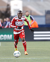 FC Dallas defender Jair Benitez (5) brings the ball forward. .  In a Major League Soccer (MLS) match, FC Dallas (red) defeated the New England Revolution (blue), 1-0, at Gillette Stadium on March 30, 2013.