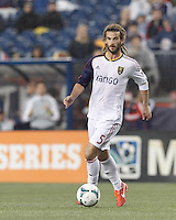 Real Salt Lake midfielder Kyle Beckerman (5) brings the ball forward.