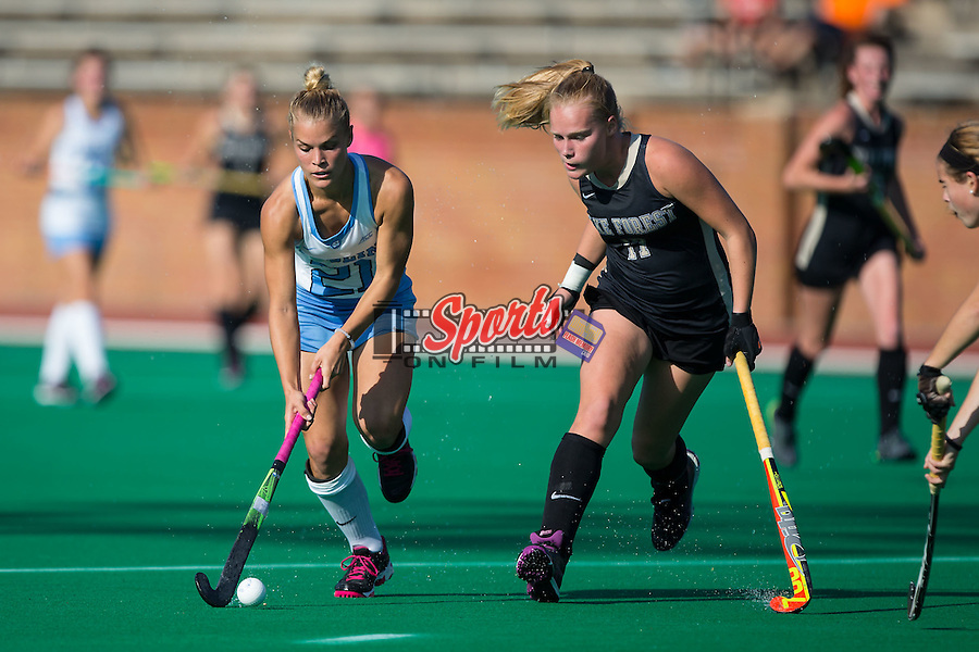 Casey Di Nardo (21) of the North Carolina Tar Heels works to get past Veerle Bos (17) of the Wake Forest Demon Deacons during second half action at Kentner Stadium on October 23, 2015 in Winston-Salem, North Carolina.  The Demon Deacons defeated the Tar Heels 3-2.  (Brian Westerholt/Sports On Film)