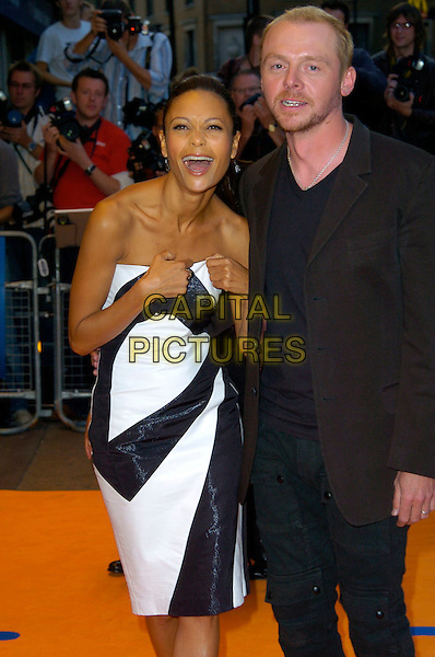"THANDIE NEWTON & SIMON PEGG.""Run Fat Boy Run"" premiere at the Odeon West End, London, England..September 3rd, 2007.half length black suit jacket 3/4 white dress strapless pulling adjusting mouth open laughing .CAP/CAN.©Can Nguyen/Capital Pictures"