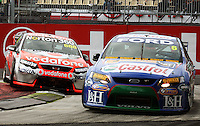 Craig Lowndes (left) tries to push inside Steven Richards at Holden Hairpin during Race Two during Day Three of the Hamilton 400 Aussie V8 Supercars Round Two at Frankton, Hamilton, New Zealand on Sunday, 19 April 2009. Photo: Dave Lintott / lintottphoto.co.nz