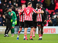 Lincoln City's Matt Rhead celebrate the victory with Harry Toffolo, left, and John Akinde, right<br /> <br /> Photographer Andrew Vaughan/CameraSport<br /> <br /> The EFL Sky Bet League Two - Lincoln City v Grimsby Town - Saturday 19 January 2019 - Sincil Bank - Lincoln<br /> <br /> World Copyright © 2019 CameraSport. All rights reserved. 43 Linden Ave. Countesthorpe. Leicester. England. LE8 5PG - Tel: +44 (0) 116 277 4147 - admin@camerasport.com - www.camerasport.com