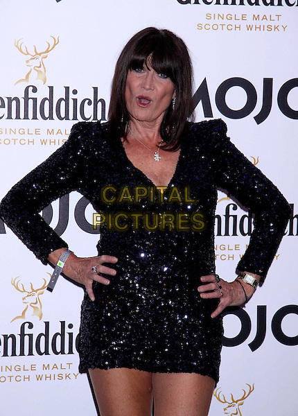 Sandie Shaw.The Glenfiddich MOJO Honours List award ceremony, the Brewery, Chiswell St., London, England..July 21st, 2011.half length sequins sequined mini dress hands on hips mouth open funny.CAP/COA/CC.©CC/COA/Capital .