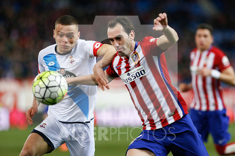 Atletico de Madrid´s Diego Godin and Deportivo de la Coruna´s Jonathan during 2015-16 La Liga match between Atletico de Madrid and Deportivo de la Coruna at Vicente Calderon stadium in Madrid, Spain. March 12, 2016. (ALTERPHOTOS/Victor Blanco)
