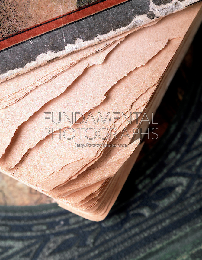 ACID DAMAGE TO BOOK PAPER<br />