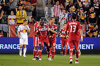 Dominic Oduro (8) of the Chicago Fire celebrates scoring with teammates. The New York Red Bulls and the Chicago Fire played to a 2-2 tie during a Major League Soccer (MLS) match at Red Bull Arena in Harrison, NJ, on August 13, 2011.