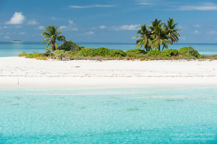 Mattidhoo Island, Huvadhoo Atoll, Maldives; a remote, deserted island in the Indian Ocean, with palm trees and white sand beaches, surrounded by a shallow coral reef