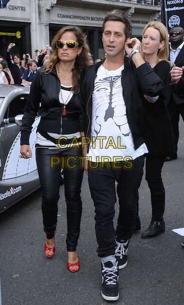JADE JAGGER.The 2010 Gumball 3000 Rally, London, England..May 1st, 2010.full length black jacket trousers red wedges shoes sunglasses shades leather .CAP/DS.©Dudley Smith/Capital Pictures