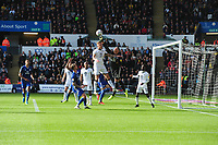 Ben Wilmot of Swansea City vies for possession with Neil Etheridge of Cardiff City during the Sky Bet Championship match between Swansea City and Cardiff City at the Liberty Stadium in Swansea, Wales, UK. Sunday 27 October 2019