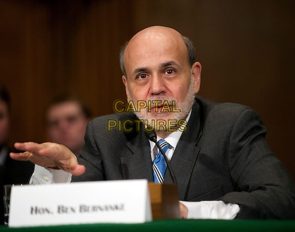 Ben Bernanke, Chairman, Board of Governors of the Federal Reserve System testifies on .The Semiannual Monetary Policy Report to the Congress.. before the United States Senate Committee on Banking, Housing, and Urban Affairs on Capitol Hill in Washington, D.C. on Thursday, March 1, 2012.  .half length black suit beard hand.CAP/ADM/RS.©Ron Sachs/Pool/CNP/AdMedia/Capital Pictures.