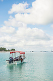 ZANZIBAR, Nungwi Beach, a Fisherman is sitting in his Boat on the turquoise water