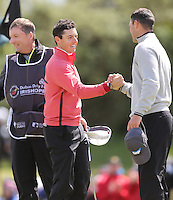 Thursday 28 May 2015; A bemused Rory McIlroy on the 18th shakes Martin Kaymer's hand.<br /> <br /> Dubai Duty Free Irish Open Golf Championship 2015, Round 1 County Down Golf Club, Co. Down. Picture credit: John Dickson / SPORTSFILE