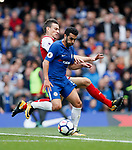 Chelsea's Pedro tussles with Arsenal's Laurent Koscielny during the premier league match at Stamford Bridge Stadium, London. Picture date 17th September 2017. Picture credit should read: David Klein/Sportimage