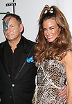 """John Demsey; Kelly Killoren Bensimon  attending Bette Midler's New York Restoration Project's Annual """"Hulaween in the Big Easy"""" at  the Waldorf Astoria on October 31, 2013  in New York City."""