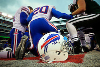 Buffalo Bills players prays after winning the game against New York Jets during their NFL game at MetLife Stadium in New Jersey. 09.05.2014. VIEWpress