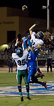 Damonte Ranch Mustangs defensive back #21 Grant Cooper jumps over Carson Senators Joeseph Thurman to break up a pass play during their football game played on Friday night, October 4, 2013 at Carson High School.