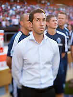 Vancouver Whitecaps head coach Martin Rennie watches his team before a Major League Soccer match at RFK Stadium in Washington, DC. D.C. United lost to the Vancouver Whitecaps, 1-0.