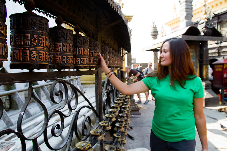 Soldier Ashley Crandall spins some prayer wheels at the Monkey Temple in Kathmandu.