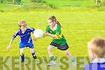 Cliona Murphy one to keep an eye out for in the future from Portmagee gathers the ball ahead of Robert Wharton of Renard.