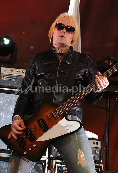 June 27, 2006; Pittsburgh, PA, USA:  Bassist RYAN SINN (The Distillers) performs with his new band, ANGELS & AIRWAVES held at the Chevrolet Ampitheatre.  Mandatory Credit:  Photo by Jason L Nelson/AdMedia  © Copyright 2006 by Jason L Nelson.