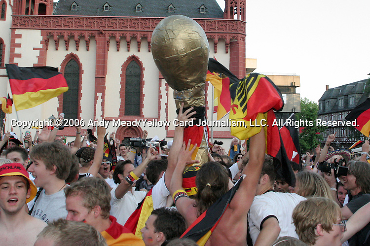 30 June 2006: Germany fans celebrate with a giant Jules Rimet trophy in the town square in Frankfurt, site of several games during the FIFA 2006 World Cup. Germany had just defeated Argentina in a Quarterfinal game played in Berlin.