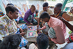 Men play a game in Kunderpara, a village on an island in the Brahmaputra River in northern Bangladesh.