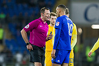 Referee James Linington speaks with Kenneth Zohore of Cardiff City during the Sky Bet Championship match between Cardiff City and Preston North End at the Cardiff City Stadium, Cardiff, Wales on 29 December 2017. Photo by Mark  Hawkins / PRiME Media Images.