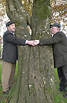 Father and son Jackie and Michael Healy-Rae were hugging trees in Kenmare after the official opening of Rossacroo-na-Loo Millennnium Forrest about four miles from Kilgarvan. The 120 acre forrest of mature oak woodland was opened  by Kerry footballer Seamus Moynihan along with a restored Yew wood near Muckross Killarney.<br />Picture by Don MacMonagle