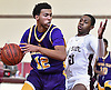 Michael Hennie #12 of Central Islip, left, gets pressured by Lavon Montgomery #20 of Bay Shore during the Suffolk County varsity boys basketball Class AA quarterfinals at Bay Shore High School on Tuesday, Feb. 21, 2017. Bay Shore won by a score of 61-34.