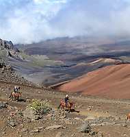 Horseback riders on the Sliding Sands Trail at Haleakala National Park, Maui.