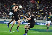 South Africa's Damien de Allende and NZ's Jack Goodhue compete for high ball during the Rugby Championship rugby union match between the New Zealand All Blacks and South Africa Springboks at Westpac Stadium in Wellington, New Zealand on Saturday, 27 July 2019. Photo: Mike Moran / lintottphoto.co.nz