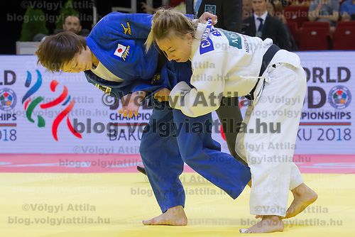 Natsumi Tsunoda (in blue) of Japan and Charline Van Snick (in white) of Belgium fight during the Women -52 kg category at the Judo Grand Prix Budapest 2018 international judo tournament held in Budapest, Hungary on Aug. 10, 2018. ATTILA VOLGYI
