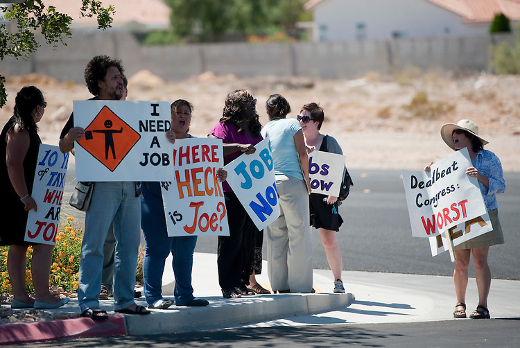 UNITED STATES - AUGUST 30: A group of protesters stand outside in 100+ degree weather as Rep. Joe Heck, R-Nev., House Education and Workforce Committee chairman John Kline, R-Minn., House Armed Services Committee chairman Buck McKeon, R-Calif., hold the House Education and Workforce Committee field hearing on Local Ideas to Reform Federal Job Training Programs on Tuesday, Aug. 30, 2011. The hearing was held in Heck's Las Vegas district at Opportunity Village, a not-for-profit organization that provides people with intellectual disabilities with vocational training. (Photo By Bill Clark/Roll Call)