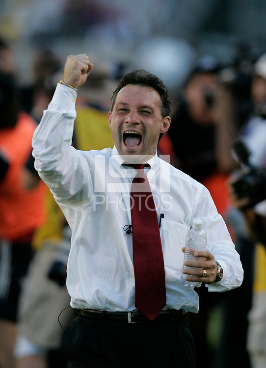 D.C. United's coach Peter Novak celebrates after defeating the Kansas City Wizards 3-2 at the MLS Cup, at the Home Depot Center, in Carson, Calif., Sunday, Oct. 14, 2004.
