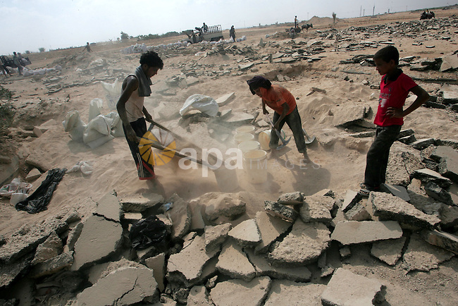 Palestinians search a destroyed runway to collect gravels at the damaged airport in Rafah, southern of Gaza Strip, August 25, 2010. Israel's blockade of the Gaza Strip was imposed after the militant Hamas group seized power in the territory three years ago. Cement and other building materials are rarely allowed by Israel to enter Gaza, and Israel says the blockade is meant to keep weapons out of Gaza and to put pressure on its Hamas rulers. Photo by Khaled Khaled